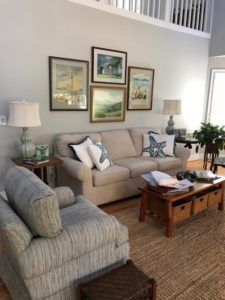 living room couch and pictures - Traditions Interiors-Wilmington, NC